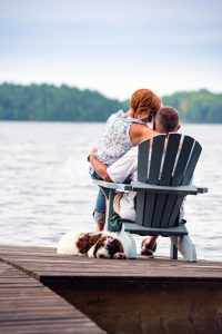Couple sitting together by the water