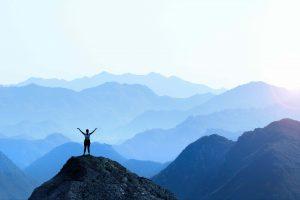 Woman atop a mountain