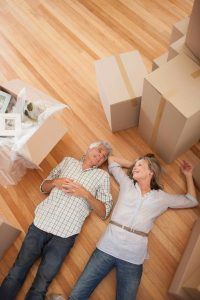 Older couple surrounded by moving boxes